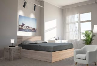 un lit coffre en bois dans sa chambre